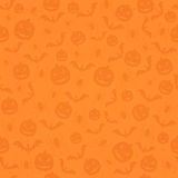 Seamless orange Halloween background with holiday icons Stock Photos