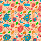 Seamless orange pattern with birds, flowers and leaves. Royalty Free Stock Images