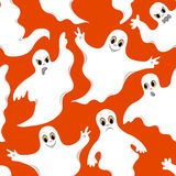 Seamless orange pattern with cute ghosts Royalty Free Stock Images