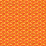 Seamless orange pattern triangles. Triangles are grouped by colors Royalty Free Stock Images