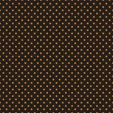 Seamless orange polka dots on black background Stock Image