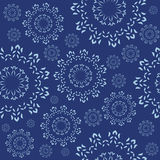 Seamless ornament with a decorative snowflakes  Stock Images