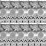 Seamless ornament from flower doodles and geometric elements in Royalty Free Stock Images