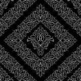 Seamless ornamental gray Pattern on black. Stock Images