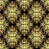 Seamless ornate floral Wallpaper: gold on black. Royalty Free Stock Photography