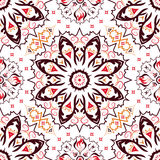 Seamless ornated pattern with red, orange and brown colors Stock Photos