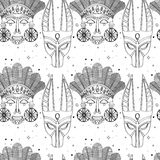 Seamless outline tribal mask pattern Stock Photos