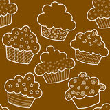Seamless outlined brown cupcakes. Outlined cupcakes on brown Royalty Free Stock Photography