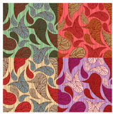 Seamless paisley backgrounds. In different colors Royalty Free Stock Image
