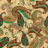 Seamless paisley in brown and yellow tones. Decorated with green leaves on a beige background Royalty Free Stock Photos