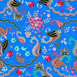 Seamless paisley floral pattern on blue background in vector. Rose, cosmos flowers,daisy and leaves and fantasy buta ornament.  stock illustration