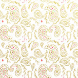 Seamless Paisley golden pattern wallpaper background Royalty Free Stock Image