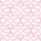 Seamless pale pink pattern with white wallpaper ornaments Stock Photography
