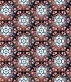 Seamless patchwork pattern from hexagons with floral ornament. Stock Image