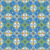 Seamless patchwork pattern from Moroccan ,Portuguese tiles blue, yellow, green colors. Decorative ornament can be used for wallpap Stock Images