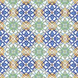 Seamless patchwork pattern from Moroccan ,Portuguese tiles blue, yellow, green colors. Decorative ornament can be used for wallpap Stock Photos