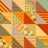 Seamless patchwork pattern in warm summer tones. Vector Royalty Free Stock Image