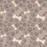 Seamless patern - pet paw print and bone Royalty Free Stock Photos