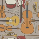 Seamless pattern. With musical instruments Stock Images