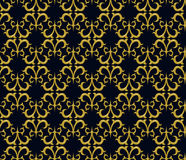 Seamless pattern. The ornament consists of elements of golden colour Stock Image