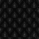 Seamless pattern of abstract cobras painted on grunge stone wall background with flame sparks Stock Images