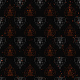 Seamless pattern of abstract cobras painted on grunge stone wall. background with flame sparks Royalty Free Stock Photo