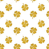 Seamless pattern of abstract four-leaf clovers of gold glitter Stock Images