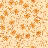 Seamless pattern of abstract leaves of palm trees on a beige background Royalty Free Stock Photo