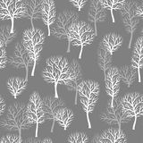 Seamless pattern with abstract stylized trees. Natural view of white silhouettes.  Stock Photography