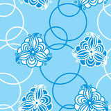 Seamless pattern of abstract white flowers and circles on a blue Stock Image