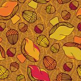 Seamless pattern with acorns, mushrooms and autumn leaves.  Autumn leaf background. Royalty Free Stock Image