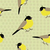 Seamless pattern with adorable yellow birds on a polkadot background. Sweet seamles pattern with little yellow birds on a neutral beige background decorated with Stock Images