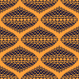 Seamless pattern. African motifs. 3D effect. Geometric background. Bright orange color. Black patterns. Ethnic style. Vector Illustration Royalty Free Stock Photo