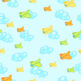 Seamless pattern of airplanes. Seamless background with cartoon airplanes and clouds vector illustration
