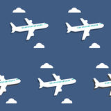 Seamless pattern. Airplanes and clouds over blue background. Royalty Free Stock Photo