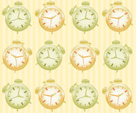 Seamless pattern of the alarms Stock Image
