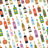 Seamless pattern with alcohol bottles Stock Images