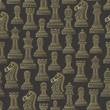 Seamless pattern with all chess pieces. Golden and black. Beautiful lace ornament in Indian style Stock Photography