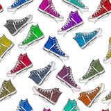 Seamless pattern  - all over pattern of colorful sneakers Stock Images