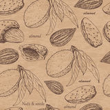 Seamless pattern with almonds on beige background Royalty Free Stock Photo