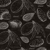 Seamless pattern with almonds on black background Royalty Free Stock Images