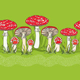 Seamless pattern with amanita and grass Stock Images