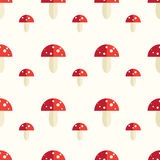 Seamless pattern with amanita mushrooms. Seamless pattern with toxic amanita mushrooms. Fly-agaric background Royalty Free Stock Images