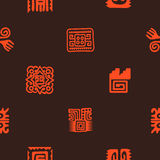 Seamless pattern with American Indians relics dingbats characters Stock Images