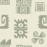 Seamless pattern with American Indians relics dingbats characters Stock Photos