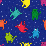 Seamless pattern with amusing cats on starry sky. Seamless vector pattern with color amusing cats on a background of blue starry sky Royalty Free Stock Images
