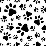 Seamless pattern with animal paws footprints. Vector illustration. Vector seamless pattern with black animal paws footprints on a white background Royalty Free Stock Photo