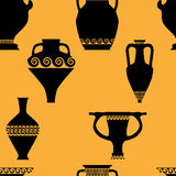 Seamless pattern with antique ceramics. Silhouettes of amphorae, pitchers and bowls Royalty Free Stock Photo