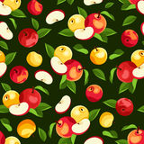 Seamless pattern with apples and leaves. Vector illustration. Vector seamless pattern with red and yellow apples and green leaves on a green background Royalty Free Stock Photo
