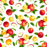 Seamless pattern with apples and leaves. Vector illustration. Vector seamless pattern with red and yellow apples and green leaves on a white background Stock Photos